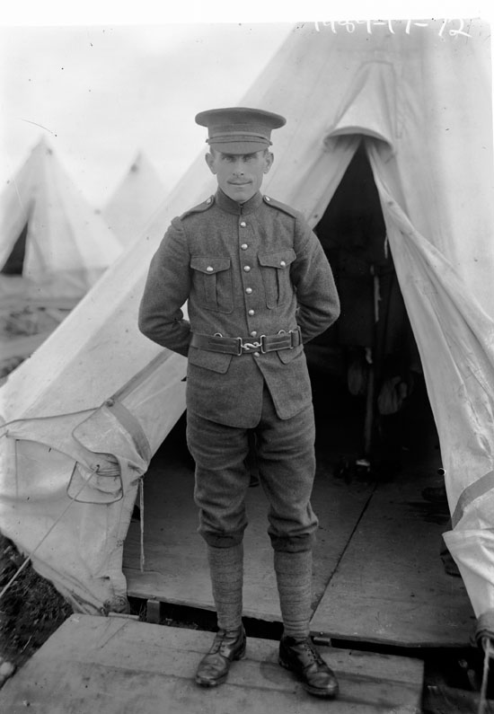 Soldier standing at entrance to tent
