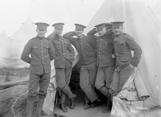Group of soldiers standing at entrance to tent