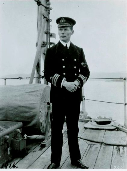 Commander Walter House stands on the deck of his ship, the HMCS Rainbow.