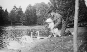 Charles Croft playing with an infant while in uniform.  Date: [1917]  Source: Saanich Archives, 2013-014-001